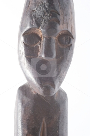 African sculpture stock photo, In West Africa the figures have elongated bodies, angular shapes, and facial features that represent an ideal rather than an individual. by Mariusz Jurgielewicz