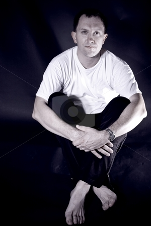 Caucasian male stock photo, Caucasian male sitting  on a black background by Mariusz Jurgielewicz