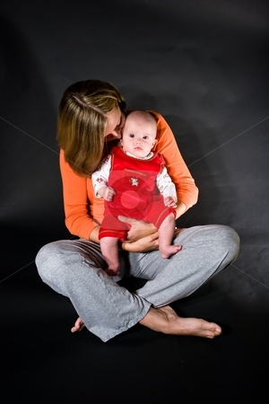 Mother and baby girl stock photo, Baby caucasian girl sitting on mother's lap by Mariusz Jurgielewicz