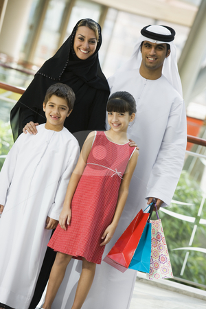 A Middle Eastern family in a shopping mall stock photo,  by Monkey Business Images