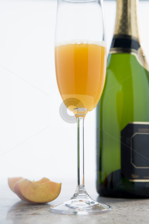 Glass of Peach Bellini stock photo,  by Monkey Business Images