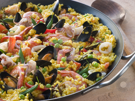 Seafood Paella in a Paella Pan stock photo,  by Monkey Business Images