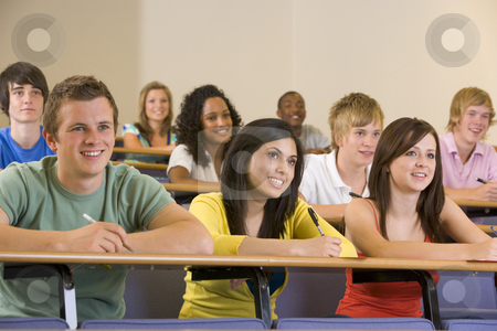 College students listening to a university lecture stock photo,  by Monkey Business Images