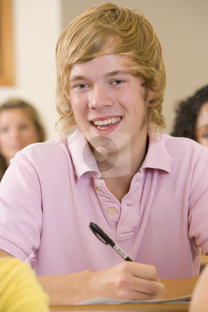 Male college student in a university lecture hall stock photo,  by Monkey Business Images