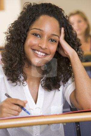 Female college student listening to a university lecture stock photo,  by Monkey Business Images