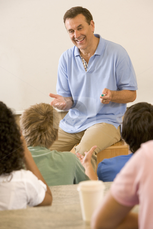 College teacher giving a lecture stock photo,  by Monkey Business Images