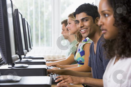 College students in a computer lab stock photo,  by Monkey Business Images