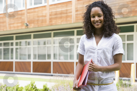Female college student on campus stock photo,  by Monkey Business Images