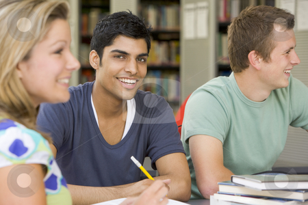 College students studying together in a library stock photo,  by Monkey Business Images