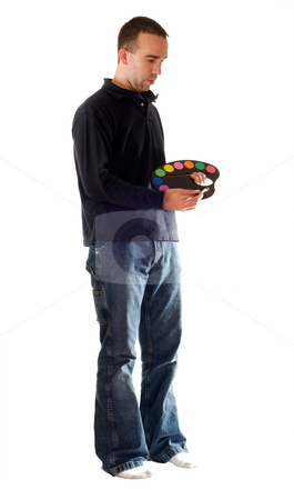 Isolated Man Painting stock photo, A full body view of a man mixing paint on his palette by Richard Nelson