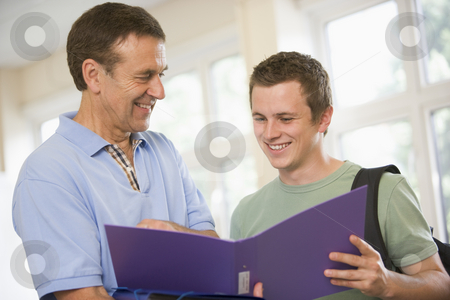 College professor providing guidance to a male student stock photo,  by Monkey Business Images