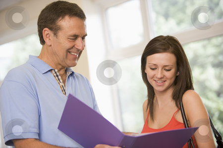College professor providing guidance to a female student stock photo,  by Monkey Business Images