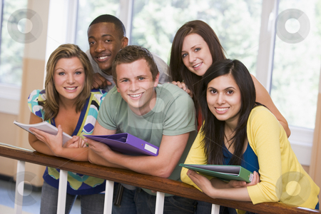 Group of college students leaning on banister stock photo,  by Monkey Business Images