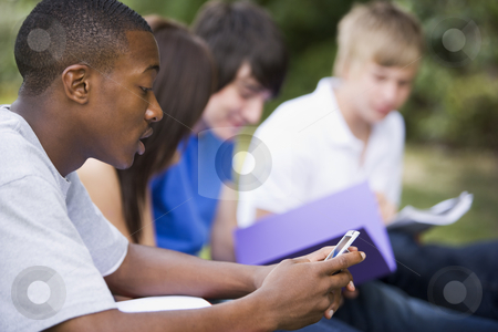 College student text messaging stock photo,  by Monkey Business Images