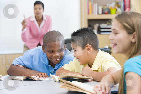 Elementary school classroom stock photo, Two boys misbehaving in elementary school classroom by Monkey Business Images