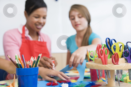 Elementary school art class stock photo, Elementary school art class with teacher by Monkey Business Images
