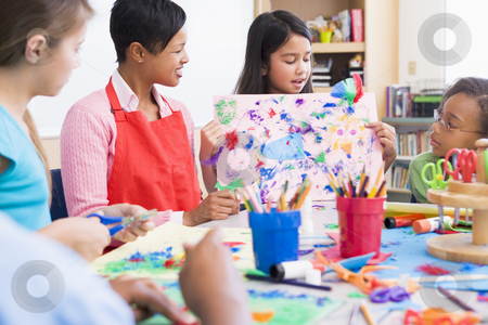 Elementary school pupil in art class stock photo, Elementary school pupil in art class showing picture to classmates by Monkey Business Images