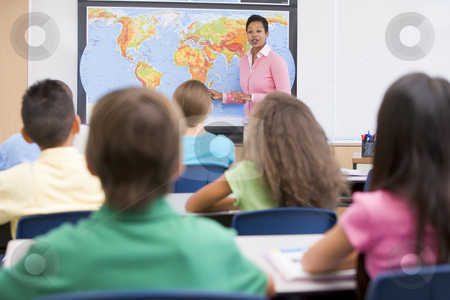 Elementary school teacher in geography class stock photo, Elementary school teacher with pupils in geography class by Monkey Business Images