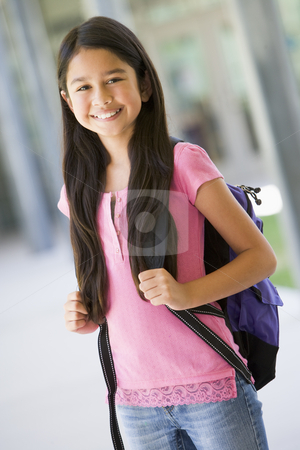Elementary school pupil outside stock photo, Elementary school pupil outside carrying rucksack by Monkey Business Images