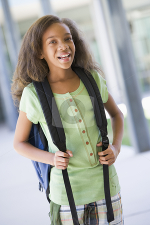 Elementary school pupil outside building stock photo, Elementary school pupil outside building with backpack by Monkey Business Images