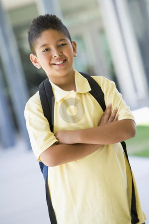 Elementary school pupil outside stock photo, Elementary school pupil outside with backpack by Monkey Business Images