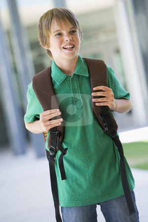 Elementary school pupil outside stock photo, Elementary school pupil outside with rucksack by Monkey Business Images