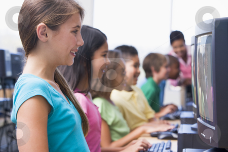 Elementary school computer class stock photo, Female pupil in elementary school computer class by Monkey Business Images
