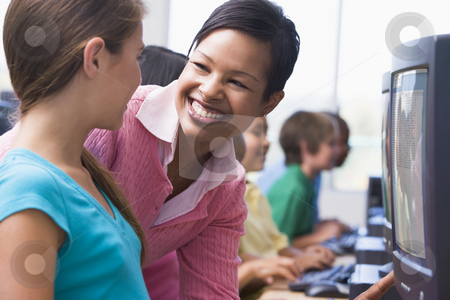 Elementary school computer class stock photo, Elementary school computer class with teacher by Monkey Business Images
