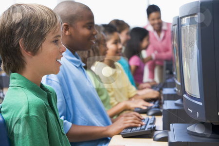 Elementary school computer class stock photo, Male pupil in elementary school computer class by Monkey Business Images