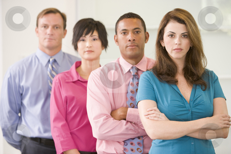 Business team standing indoors stock photo,  by Monkey Business Images