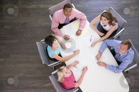 Five businesspeople at boardroom table stock photo,  by Monkey Business Images