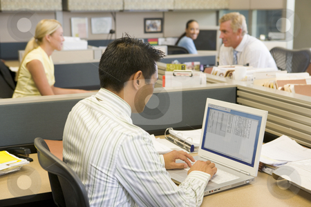 Businessman in cubicle at laptop stock photo,  by Monkey Business Images