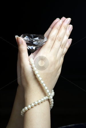 Praying female hands with diamond and pearls stock photo, Praying female hands with diamond and pearls on black background by Wong Chee Yen