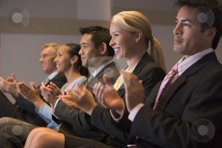 Five businesspeople applauding and smiling in presentation room stock photo,  by Monkey Business Images