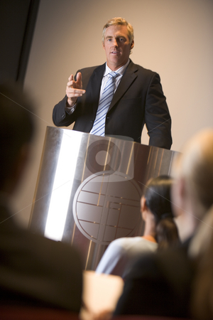 Businessman giving presentation at podium stock photo,  by Monkey Business Images