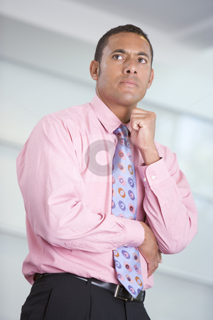 Businessman standing indoors stock photo,  by Monkey Business Images