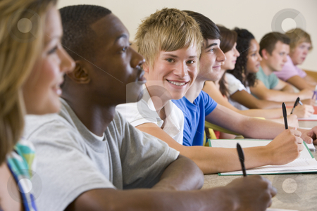 College students in a university lecture stock photo,  by Monkey Business Images