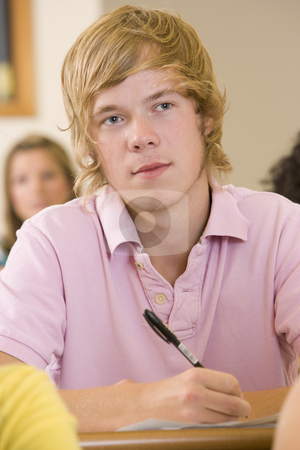 Male college student listening to a university lecture stock photo,  by Monkey Business Images