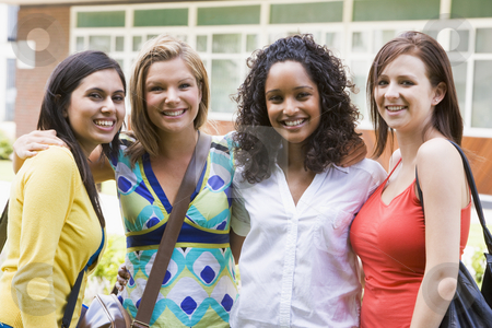 Female college friends on campus stock photo,  by Monkey Business Images