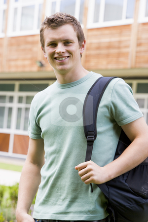 Male college student on campus stock photo,  by Monkey Business Images