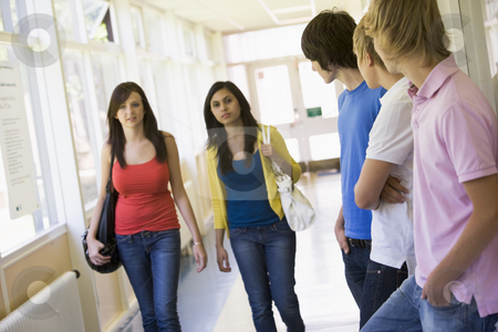 Male college students watching female students walking down univ stock photo,  by Monkey Business Images