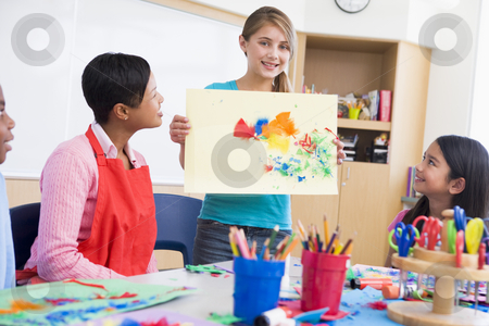 Elementary school pupil in art class stock photo, Elementary school pupil talking about picture in art class by Monkey Business Images