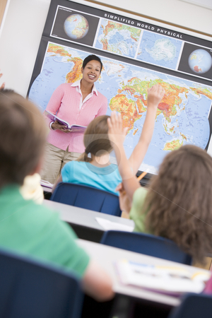 Teacher in elementary school geography class stock photo, Teacher in elementary school geography class answering questions by Monkey Business Images