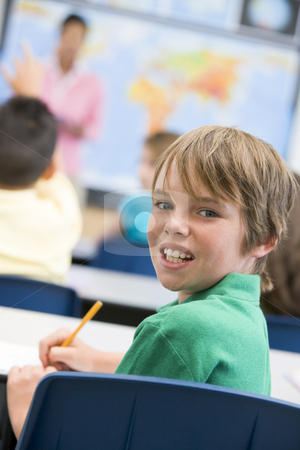 Elementary school pupil in classroom stock photo, Elementary school pupil in geography class by Monkey Business Images