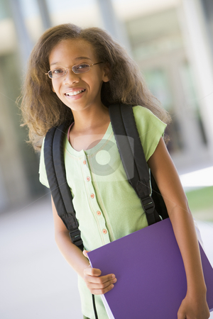 Elementary school pupil outside stock photo, Elementary school pupil outside carrying file by Monkey Business Images