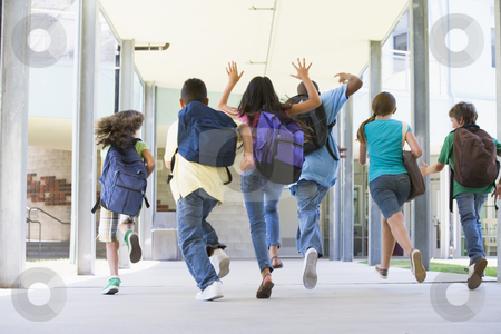 Elementary school pupils running outside stock photo, Rear view of elementary school pupils running outside by Monkey Business Images