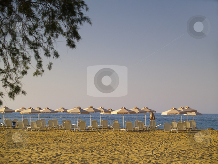 Sunbeds stock photo, Sunbeds on a beach at malia, crete, greece by Torsten Lorenz