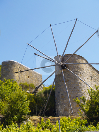 Cretan windmills stock photo, Two derelict cretan windmills by Torsten Lorenz