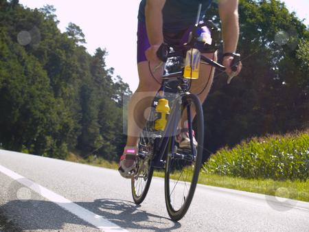 Triathlete stock photo, Triathlete on bicycle by Torsten Lorenz