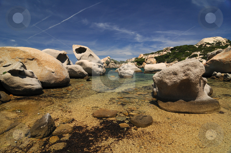 View of a lagoon stock photo, View of a sardinian lagoon, big granite rocks by Federico Stevanin